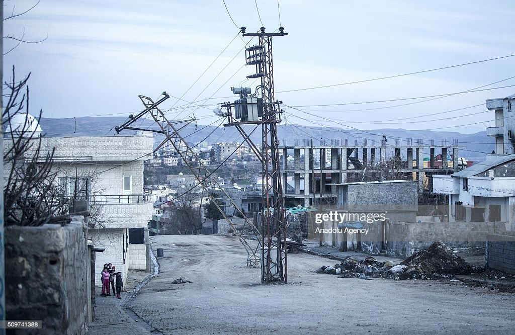 Transmission towers which was damaged by PKK terrorists is seen as Turkish security forces patrol around after counter-terror operation in Cizre, the southeastern Turkish town that has seen fighting rage between security forces and PKK terrorists finished, on February 12, 2016.
