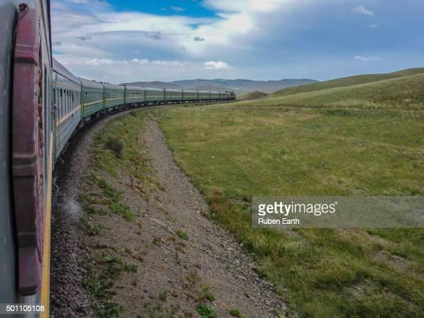 Transmongolian train trough Mongolian landscape in his way to Ulan Bator