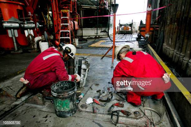 Transocean Ltd workers perform maintenance on the drill floor of the Development Driller II rig which is drilling a relief well at the BP Plc Macondo...