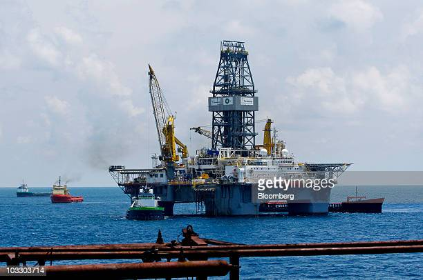 Transocean Ltd's Development Driller III rig works to drill a primary relief well as seen from the deck of the Development Driller II rig at the BP...