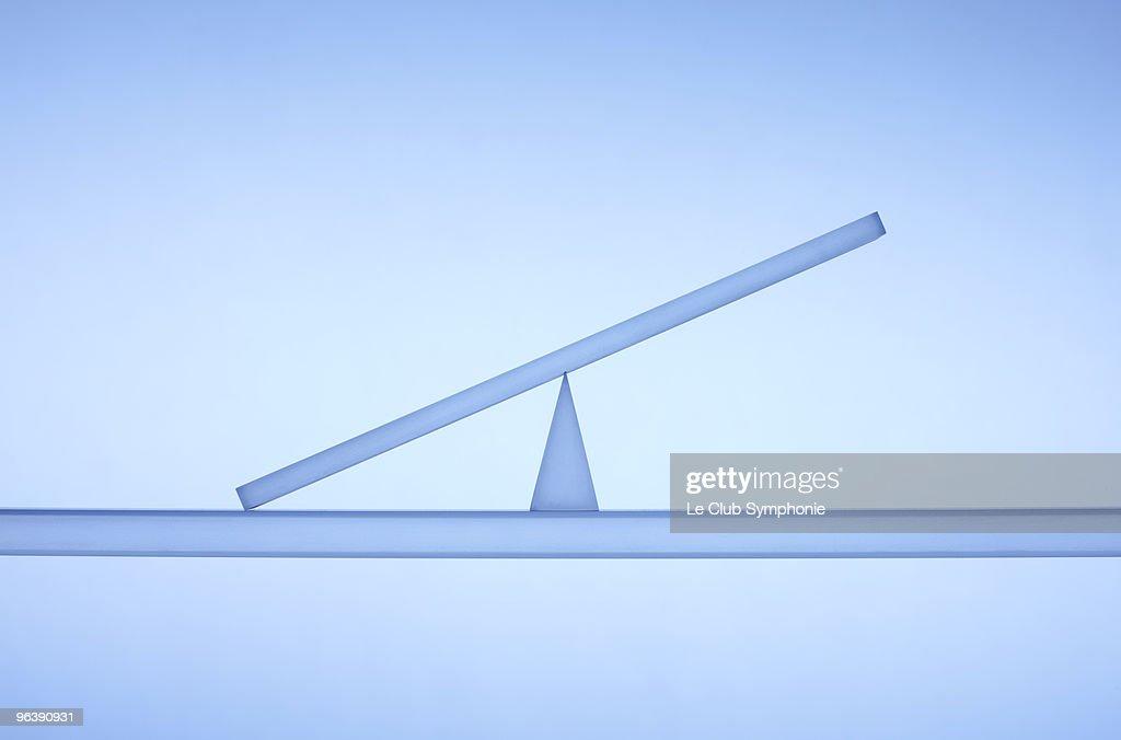 Transparent balance tilted to one side