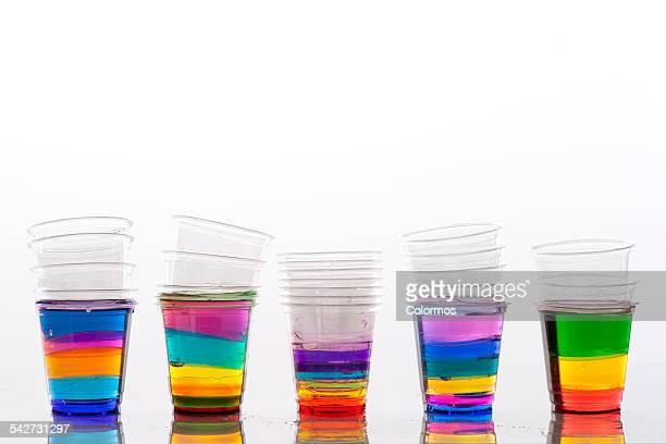 Transparent cups containing separated liquids
