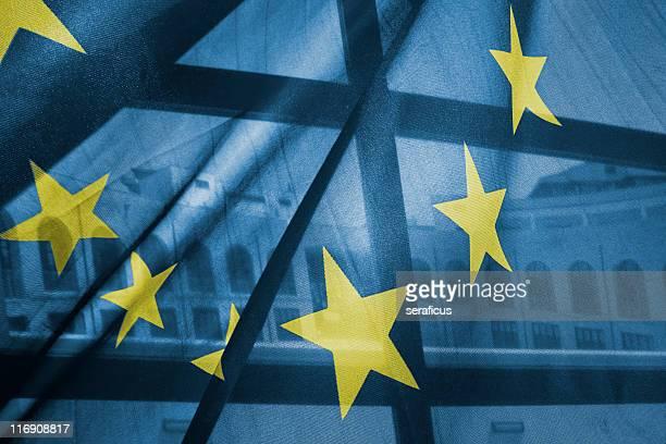 A transparent European Union flag obscures partly a building