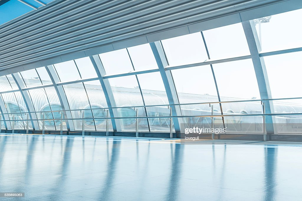 transparent glass wall and corridor in airport : Stock Photo