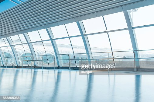 transparent glass wall and corridor in airport : Bildbanksbilder