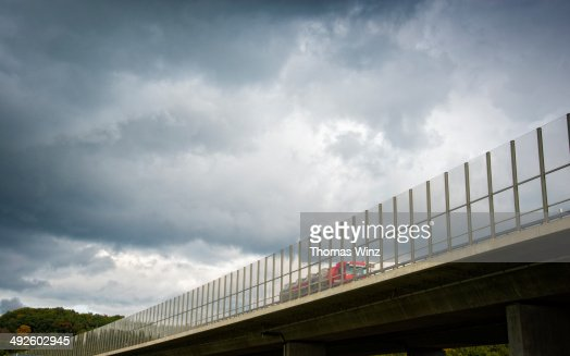 Transparent noise barrier on a freeway bridge