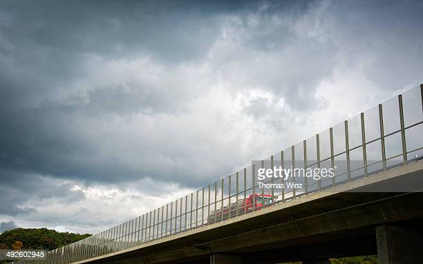 Transparent noise barrier on a freeway bridge