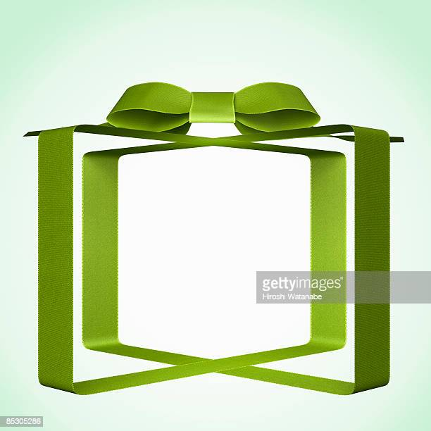 Transparent present wrapped by green ribbon