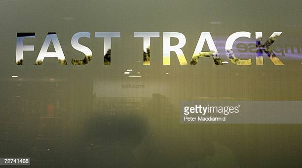 A transparent sign shows the entrance to the Fast Track security gate at terminal three on December 6 2006 at London's Heathrow airport England...