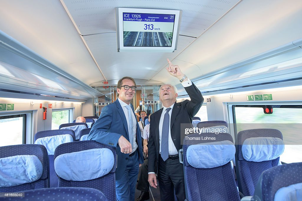 Transport and Digital Technologie Mininister Alexaner Dobrindt (CSU, L) and Deutsche Bahn CEO Ruediger Grube (R) look to a monitor in the new ICE 3 that shows the train speed of 313 KM/h on July 23, 2015 near Paris, France. The new ICE 3 in the Franco-German high-speed rail has been officially launched with a trip from Frankfurt to Paris.