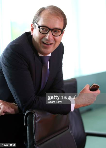 Transport and Digital Technologies Minister Alexander Dobrindt arrives for the weekly German federal Cabinet meeting on July 16 2014 in Berlin...