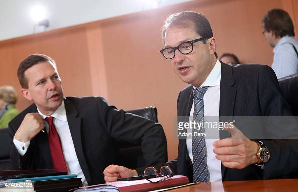 Transport and Digital Technologies Minister Alexander Dobrindt speaks to government speaker Steffen Seibert as he arrives for the weekly German...