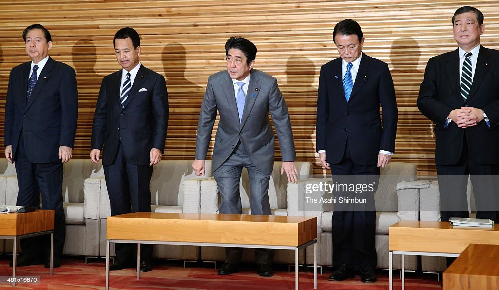 Transport Minister <a gi-track='captionPersonalityLinkClicked' href=/galleries/search?phrase=Akihiro+Ota&family=editorial&specificpeople=4237397 ng-click='$event.stopPropagation()'>Akihiro Ota</a>, Economy Revitalization Minister <a gi-track='captionPersonalityLinkClicked' href=/galleries/search?phrase=Akira+Amari&family=editorial&specificpeople=3868034 ng-click='$event.stopPropagation()'>Akira Amari</a>, Prime Minister <a gi-track='captionPersonalityLinkClicked' href=/galleries/search?phrase=Shinzo+Abe&family=editorial&specificpeople=559017 ng-click='$event.stopPropagation()'>Shinzo Abe</a>, Finance Minister <a gi-track='captionPersonalityLinkClicked' href=/galleries/search?phrase=Taro+Aso&family=editorial&specificpeople=559212 ng-click='$event.stopPropagation()'>Taro Aso</a> and Local Economy Vitalization Minister <a gi-track='captionPersonalityLinkClicked' href=/galleries/search?phrase=Shigeru+Ishiba&family=editorial&specificpeople=2921096 ng-click='$event.stopPropagation()'>Shigeru Ishiba</a> are seen prior to the cabinet members meeting to approve a record budget at Abe's official residence on January 14, 2015 in Tokyo, Japan. The Cabinet approved a record 96.342 trillion Japanese yen (approximately 815 billion U.S. dollars) budget for fiscal 2015 that relies on government bonds for close to 40 percent of revenues. An increase in the consumption tax rate in April, from 5 percent to 8 percent, coupled with robust corporate performance, led to a projected spike in tax revenues to 54.5 trillion yen, a 9-percent increase from the initial fiscal 2014 budget. That level of tax revenue was last reached in fiscal 1991.