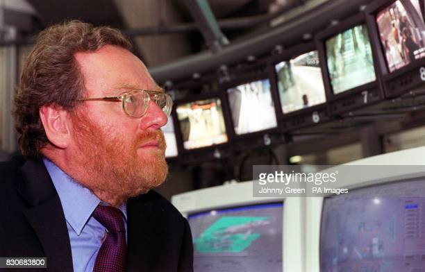 Transport Minister John Spellar looks at a bank of TV screens during his visit to the closedcircuit television control room where he discussed crime...