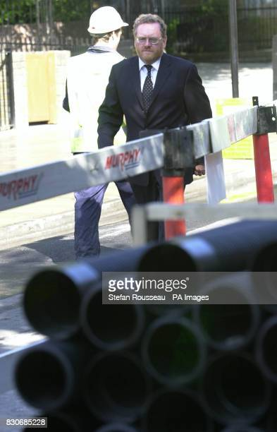 Transport Minister John Spellar walks past roadworks in Kings Cross London where he launched a trial scheme urging local authorities to charge...