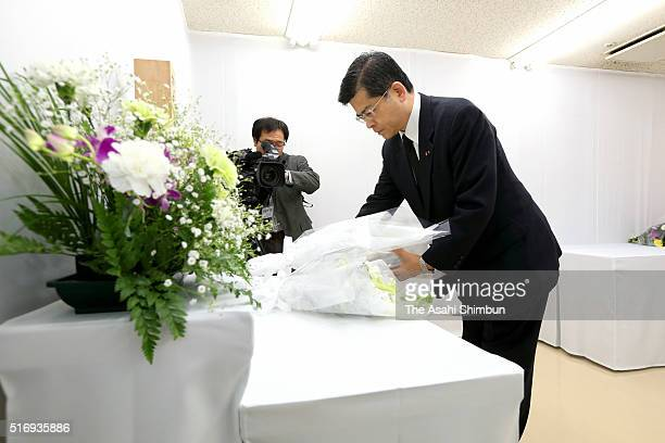 Transport Minister Keiichi Ishii offers a flower bouquet at an altar for the victims at the Tokyo Metro Kasumigaseki Station on March 20 2016 in...