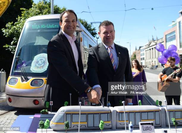 Transport Minister Leo Varadkar and Minister of State Alan Kelly cut a LUAS birthday cake at St Stephen's Green to help celebrate Dublin's LUAS tram...
