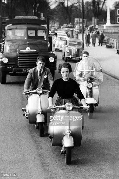 circa 1959 Great Britain A trio of Vespa motor scooters with young riders