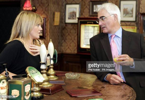 Transport Secretary Alistair Darling drinks an orange juice as he chats with Coronation Street star Sally Lindsey who plays Shelley Unwin on the set...