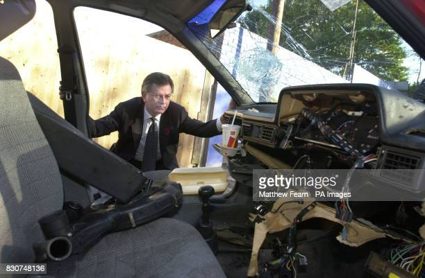 Transport Secretary Stephen Byers inspects one of Britain's abandoned cars in Catford in London Byers launched a package of measures to crack down on...