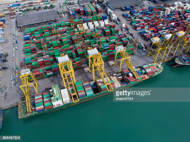 Transportation, container ship in import export and business logistic, by crane , Trade Port , Shipping , cargo to harbor , Aerial view ,Top view