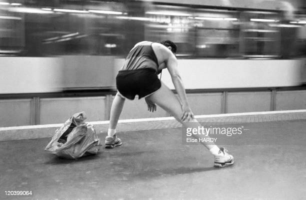 Transportation in Paris France in 2003 A man prepares for the marathon at the RER station in 1993