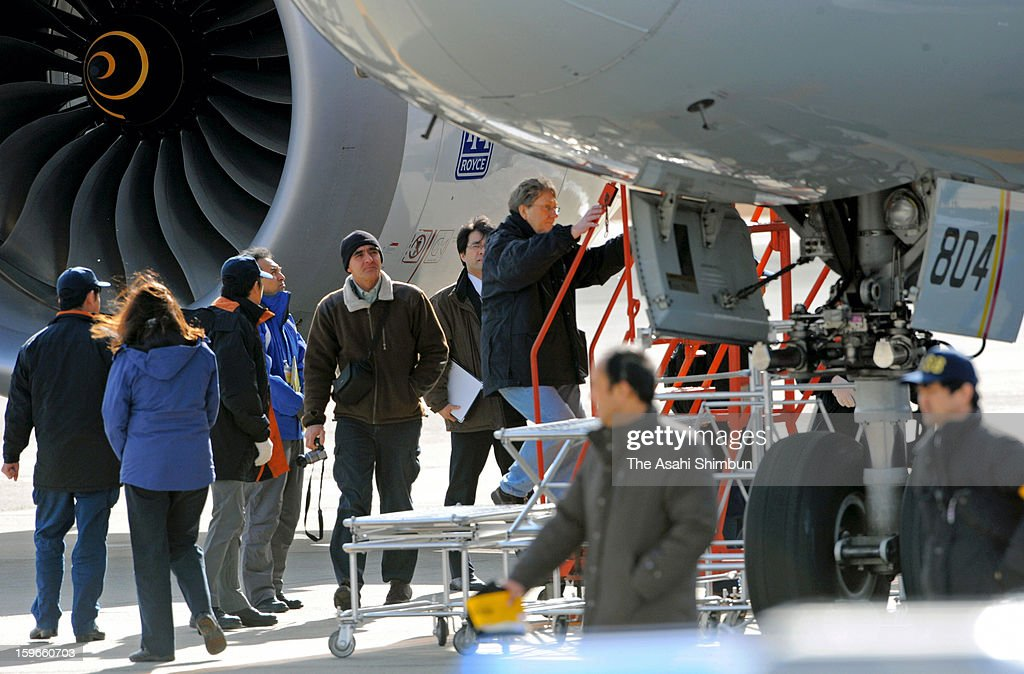 U.S. Transportation Safety Board (NTSB) investigator, Federal Aviation Administration (FAA), and Boeing Co staffs investigate a Boeing 787 aircraft that made an emergency landing at Takamatsu Airport on January 18, 2013 in Takamatsu, Kagawa, Japan.