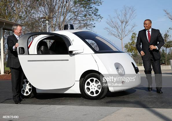S Transportation Secretary Anthony Foxx and Google Chairman Eric Schmidt get out of a Google selfdriving car at the Google headquarters on February 2...
