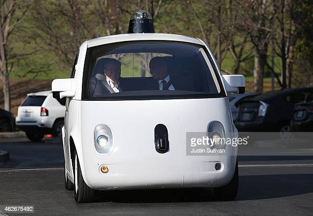S Transportation Secretary Anthony Foxx and Google Chairman Eric Schmidt ride in a Google selfdriving car at the Google headquarters on February 2...