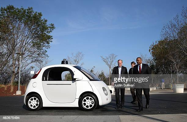 S Transportation Secretary Anthony Foxx and Google Chairman Eric Schmidt walk around a Google selfdriving car at the Google headquarters on February...