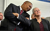 US Transportation Secretary Anthony Foxx chats with EPA Administrator Gina McCarthy as they attend an event where President Barack Obama made remarks...