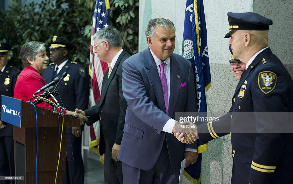Transportation Secretary Ray LaHood shakes hands with an Amtrak Police officer at Union Station after the news conference on Thursday, Oct. 4, 2012, with Homeland Security Secretary Janet Napolitano, left, and Amtrak President and CEO Joseph Boardmanto, center, to announce a new partnership to combat human trafficking.