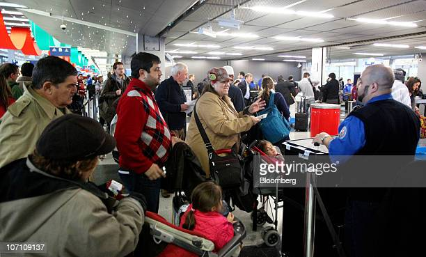 A US Transportation Security Administration agent checks travel tickets at a security checkpoint at O'Hare International Airport in Chicago Illinois...