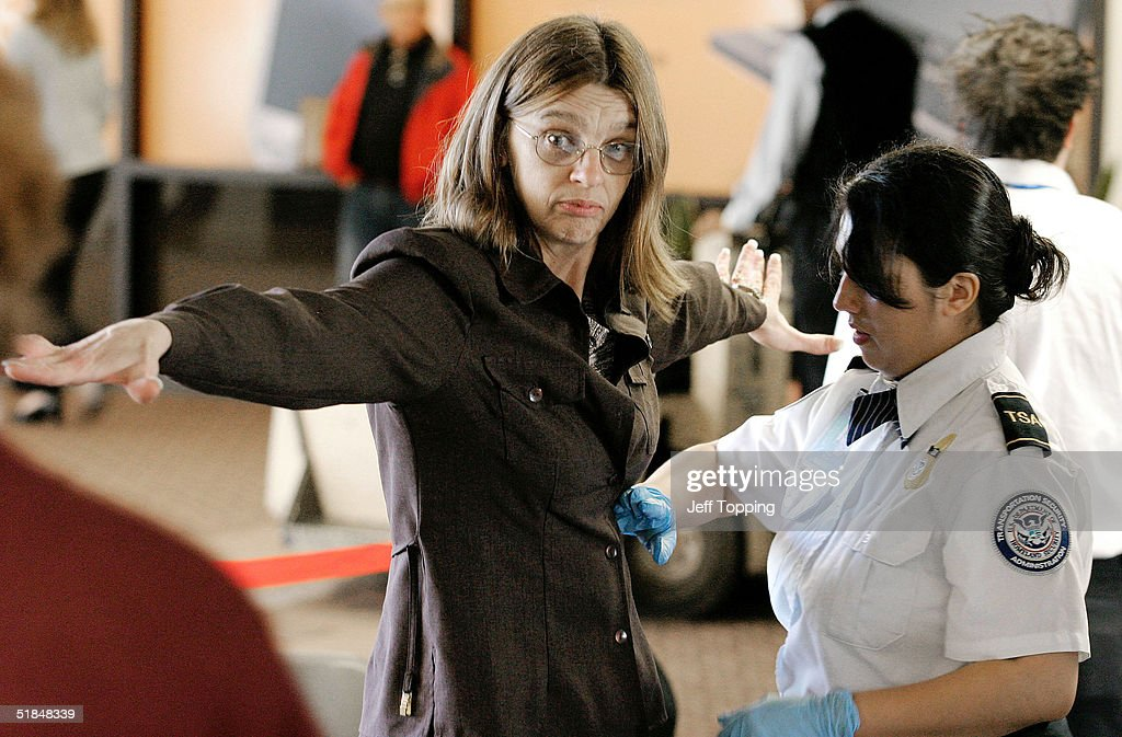 A Transportation Security Administration agent performs a pat-down check on an airline passenger at a security checkpoint in terminal four at Phoenix Sky Harbor International Airport December 10, 2004 in Phoenix, Arizona. Beginning December 13, passengers will be allowed to stand normally with arms at their sides during the last part of the security check. Screeners will continue to pat down some passengers, including women, despite complaints against the practice.