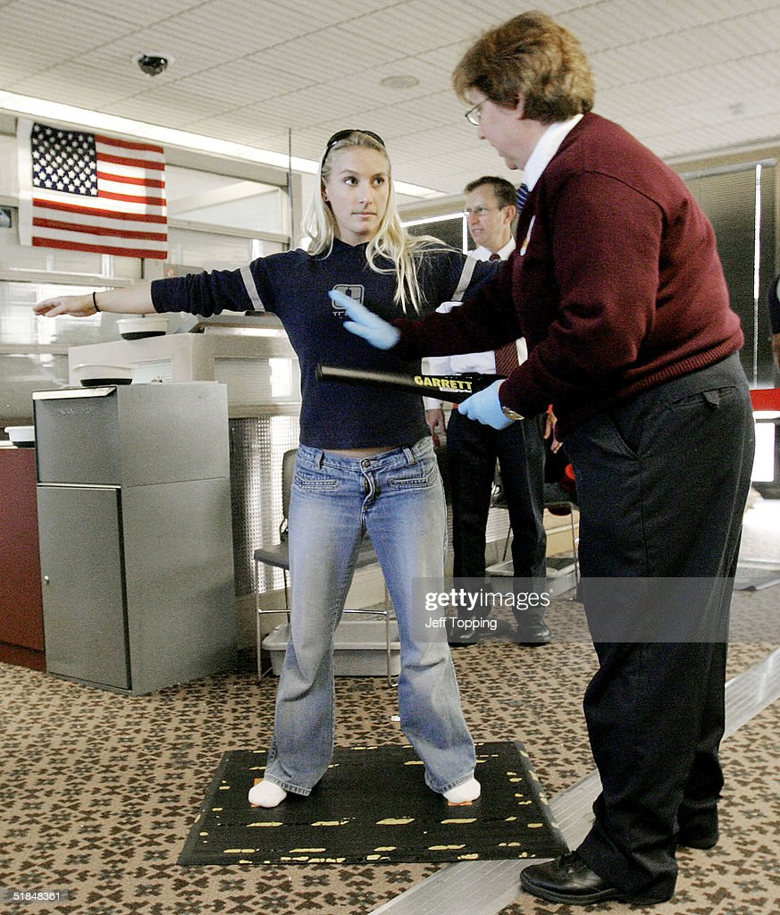 A Transportation Security Administration agent performs a patdown check on an airline passenger at a security checkpoint in terminal four at Phoenix Sky Harbor International Airport December 10, 2004 in Phoenix, Arizona. Beginning December 13, passengers will be allowed to stand normally with arms at their sides during the last part of the security check. Screeners will continue to pat down some passengers, including women, despite complaints against the practice.
