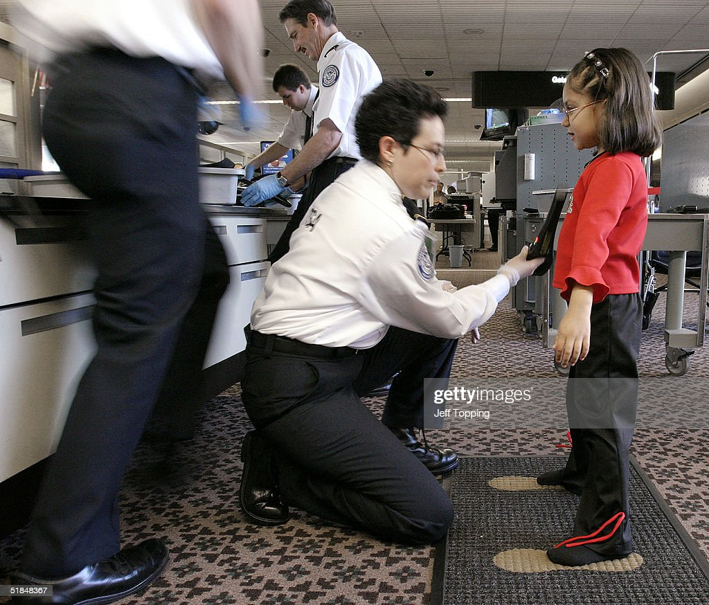 A Transportation Security Administration agent performs a pat-down check on a young girl at a security checkpoint in terminal four at Phoenix Sky Harbor International Airport December 10, 2004 in Phoenix, Arizona. Beginning December 13, passengers will be allowed to stand normally with arms at their sides during the last part of the security check. Screeners will continue to pat down some passengers, including women, despite complaints against the practice.