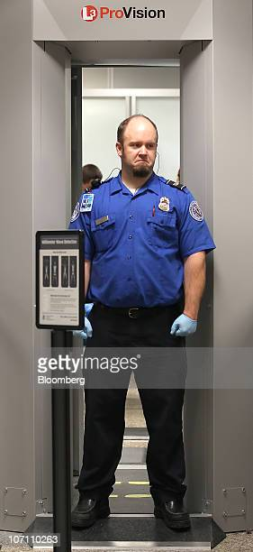 A US Transportation Security Administration agent stands at a body scanner at the Salt Lake City International Airport in Salt Lake City Utah US on...