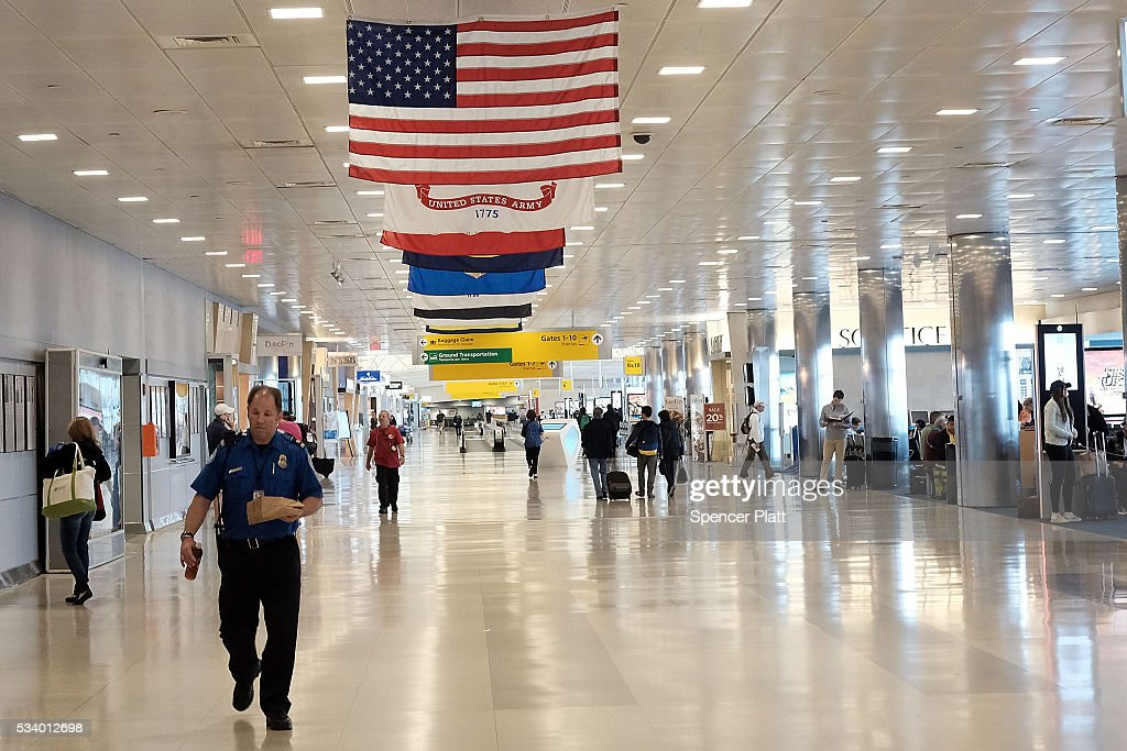 A Transportation Security Administration (TSA) agent walks through John F. Kennedy (JFK) Airport on May 24, 2016 in New York, New York. The TSA has come under renewed criticism from government officials and the general public following an escalation of wait times at security screenings at domestic airports as the summer travel season begins. Kelly Hoggan, the Transportation Security Administration's head of security operations, has been put on paid administrative leave pending reassignment.