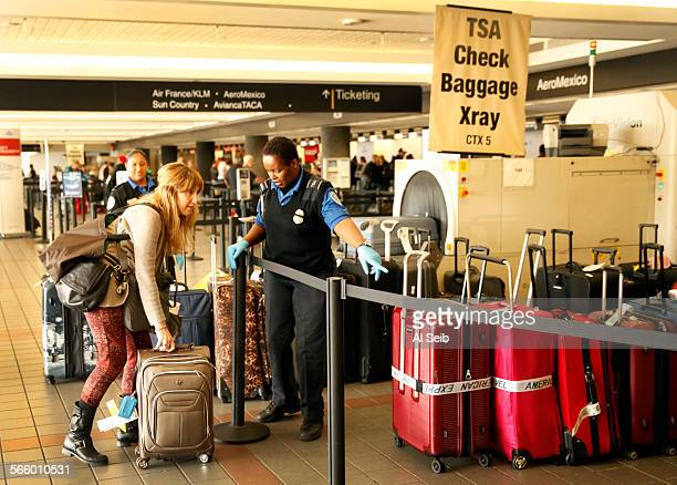 Transportation Security Administration agents help travelers with baggage to check for screening at LAX terminal two on Monday morning November 04...