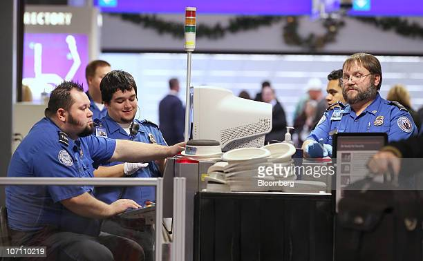 US Transportation Security Administration agents screen carryon luggage at the Salt Lake City International Airport in Salt Lake City Utah US on...