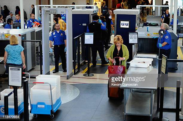 Transportation Security Administration agents screen passangers at Los Angeles International Airport on May 2 2011 in Los Angeles California Security...
