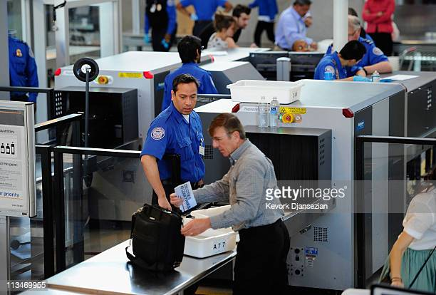 Transportation Security Administration agents screen passengers at Los Angeles International Airport on May 2 2011 in Los Angeles California Security...