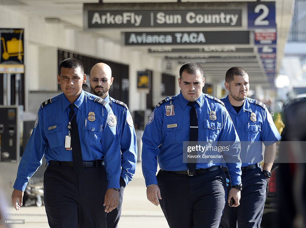 Transportation Security Administration agents walk on the departures level a day after a shooting that killed one Transportation Security Administration worker and injured several others at Los Angeles International Airport November 2, 2013 in Los Angeles, California. The airport is almost back to normal operations a day after a man pulled an assault rifle and shot his way through security at Terminal 3, killing one Transportation Security Administration worker and wounding several others. Federal officials identified the alleged gunman as Paul Ciancia, 23, of New Jersey.