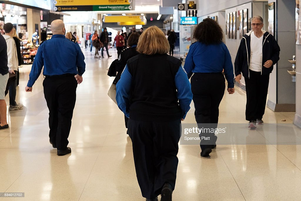 Transportation Security Administration (TSA) agents walk through John F. Kennedy (JFK) Airport on May 24, 2016 in New York, New York. The TSA has come under renewed criticism from government officials and the general public following an escalation of wait times at security screenings at domestic airports as the summer travel season begins. Kelly Hoggan, the Transportation Security Administration's head of security operations, has been put on paid administrative leave pending reassignment.
