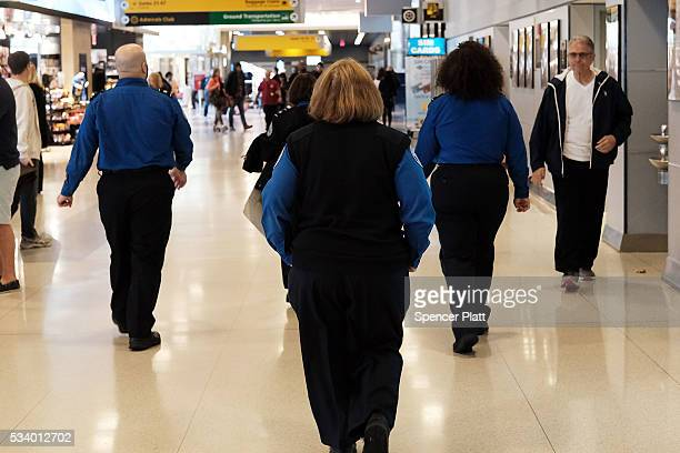 Transportation Security Administration agents walk through John F Kennedy Airport on May 24 2016 in New York New York The TSA has come under renewed...