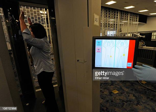 S Transportation Security Administration employee demonstrates an advanced image technology millimeter wave scanner using new Automated Target...