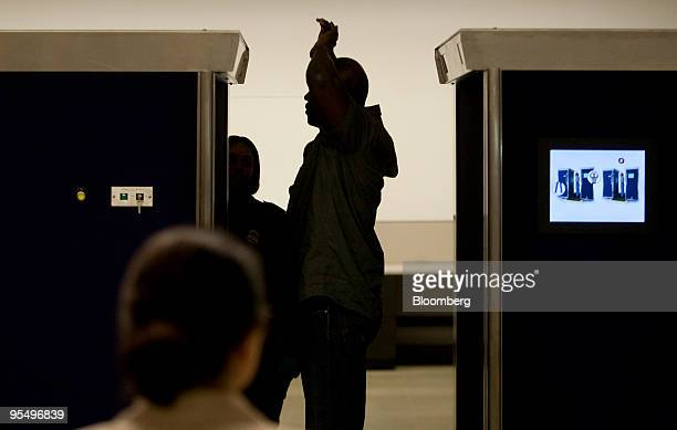 A Transportation Security Administration employee demonstrates the Rapiscan Backscatter advanced imaging technology machine currently in testing at...