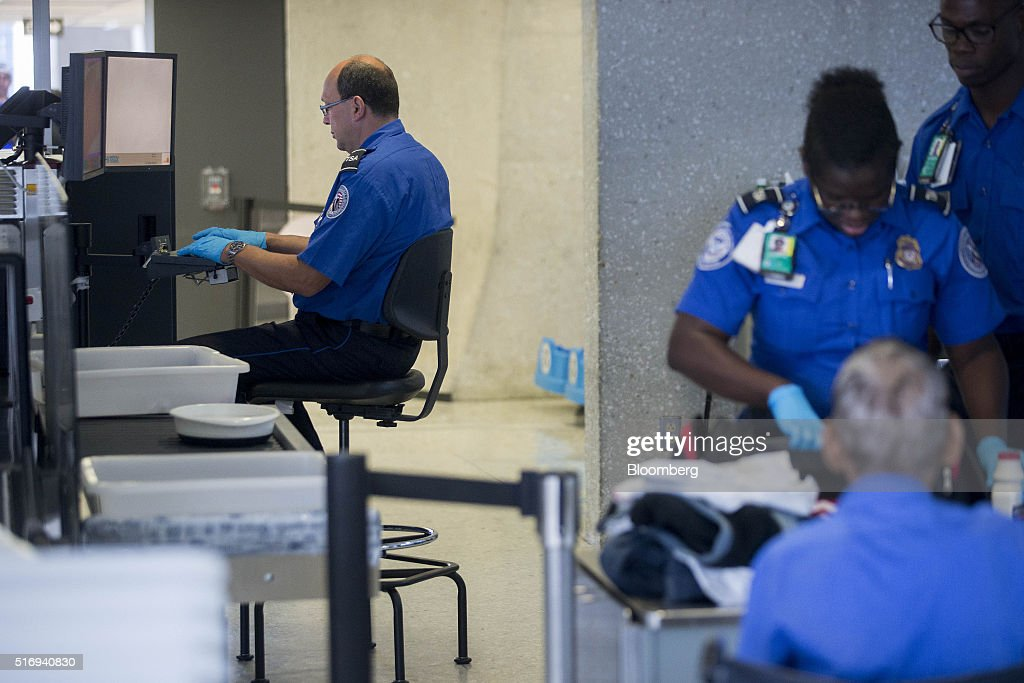 a transportation security administration tsa officer operates an x ray machine in the - Transportation Security Officer
