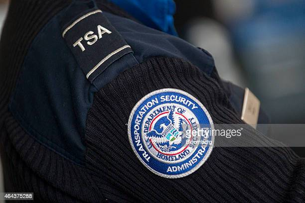 A Transportation Security Administration officer works at a security checkpoint at Ronald Reagan National Airport in Washington DC US on Wednesday...