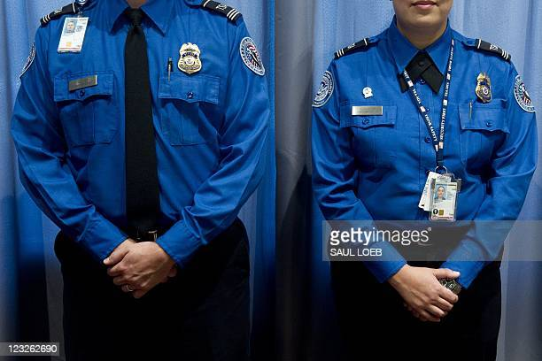 transportation security administration officers stand alongside a temporary exhibit on the september 11 2001 attacks at - Transportation Security Officer